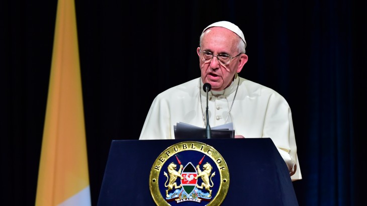 """Pope Francis delivers a speech at the State House of Nairobi on November 25, 2015. Pope Francis said the world was facing a """"grave environmental crisis"""" as he arrived in Kenya on Wednesday on a landmark Africa trip just days before a crucial UN summit aimed at curbing climate change. He also warned of the need to tackle poverty as a key driver of conflict and violence as he kicked off a landmark Africa trip fraught with security concerns and urged Kenya's leaders to work with """"transparency"""" to ensure a fair distribution of national resources as criticism grows over runaway graft in this east African country. AFP PHOTO / GIUSEPPE CACACE / AFP / GIUSEPPE CACACE"""